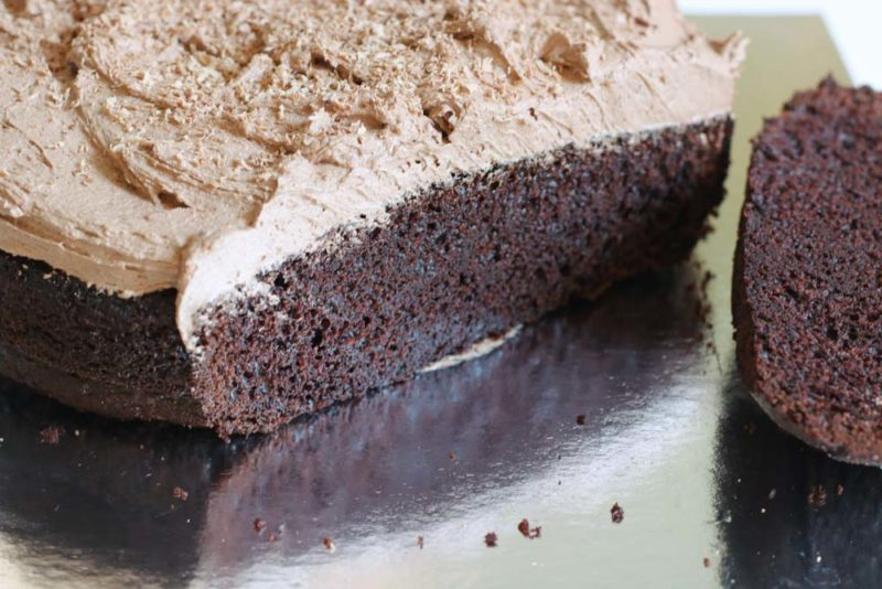 Sliced chocolate cake with buttercream icing
