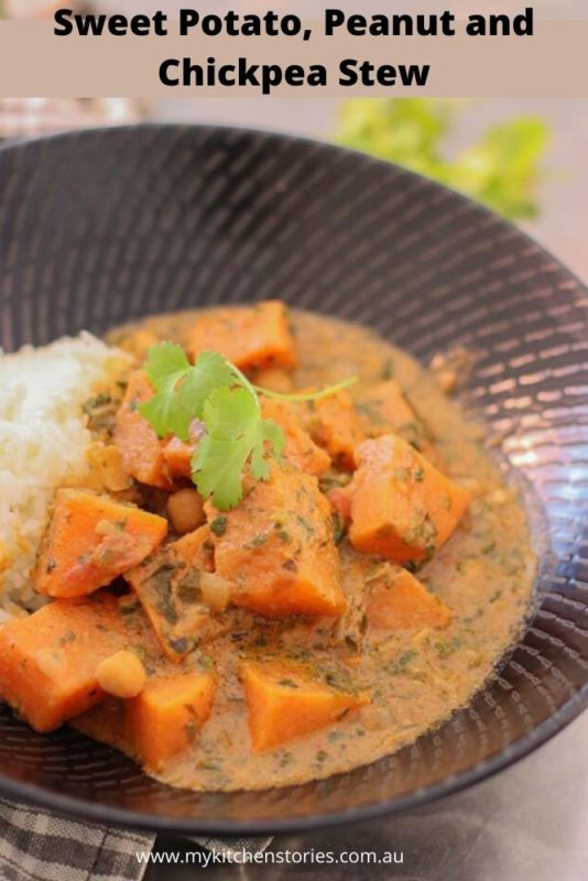 Sweet potato and peanut stew in a black bowl