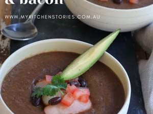 blackbean soup with bacon in a white bowl