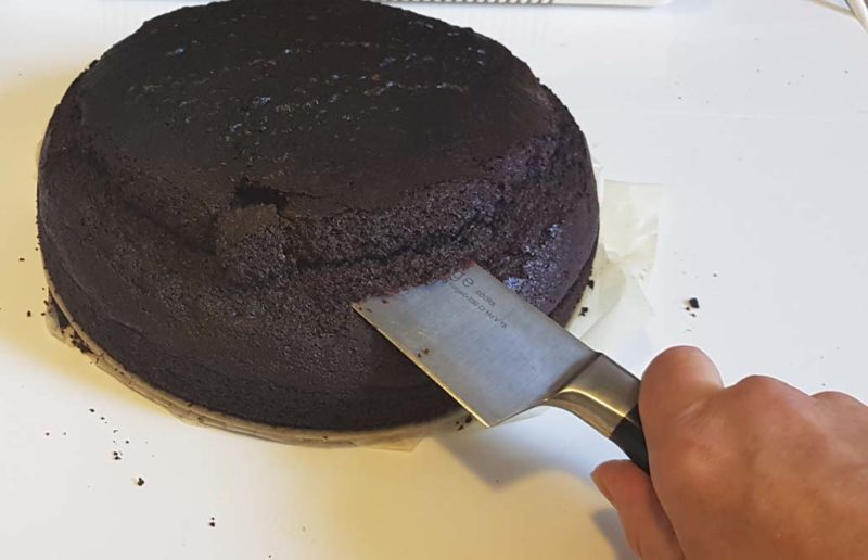 cutting the top off the Chocolate cake