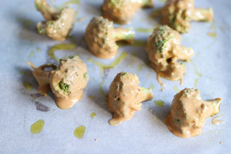 A tray of Broccoli covered in batter and baked