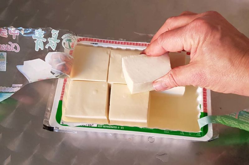 A packet of tofu showing the texture