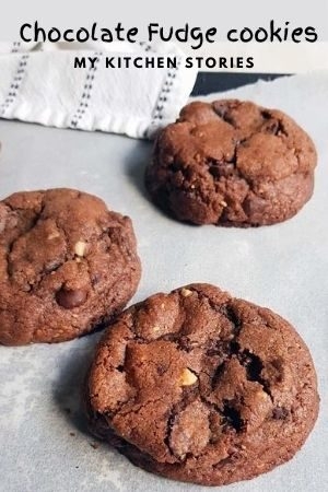 3 chunky chocolate cookies on a baking tray