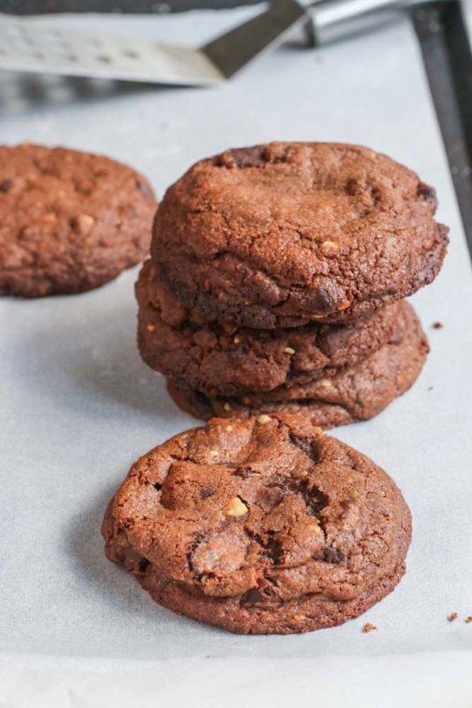 big chocolate cookies-stacked-on-a-plate