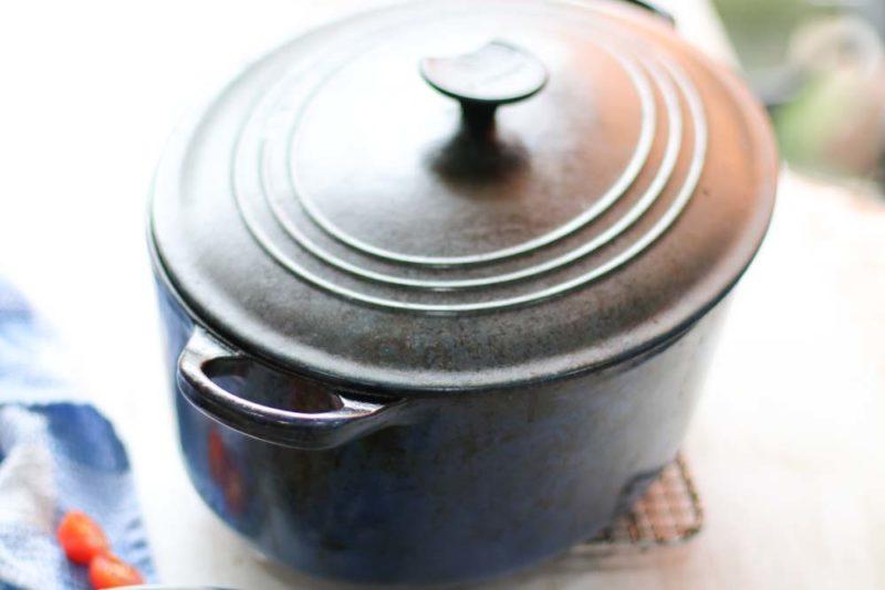 a blue le cruset pot on a table