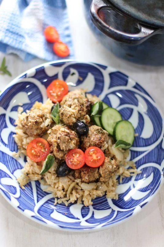 Lamb meatball and lemony rice on a blue plate
