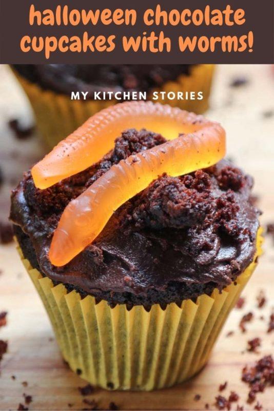 Chocolate cupcake with an orange jelly worm for halloween