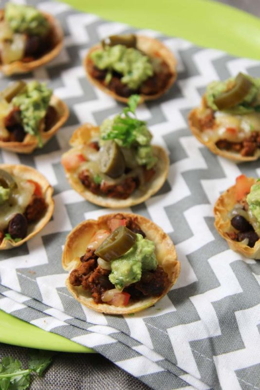 Aselection of tiny tostadas on a bright teatowel