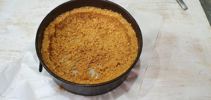 pushing crumbs into a tin