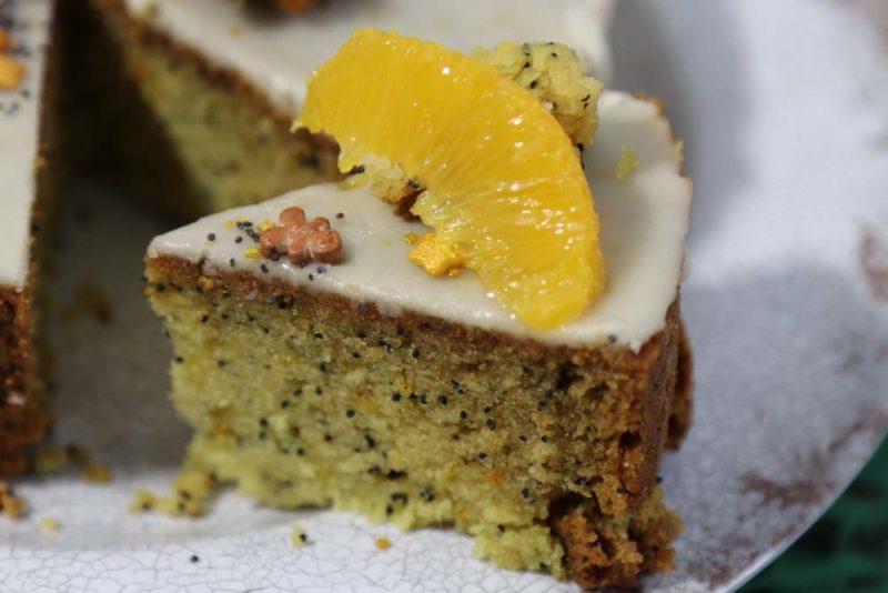 Orange poppyseed cake sliced on a plate