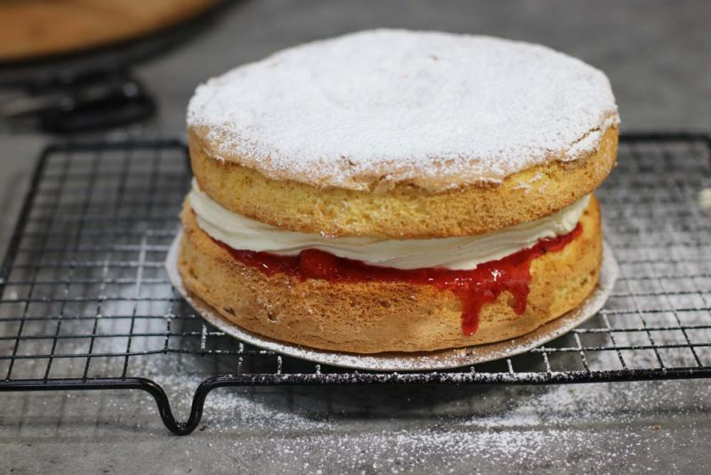 A jam and cream sponge cake with dripping jam