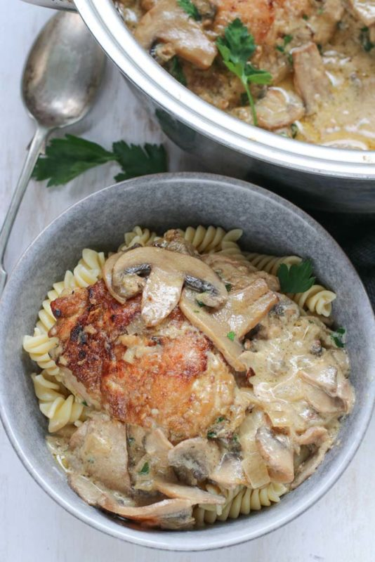 Roasted chicken pieces and pasta