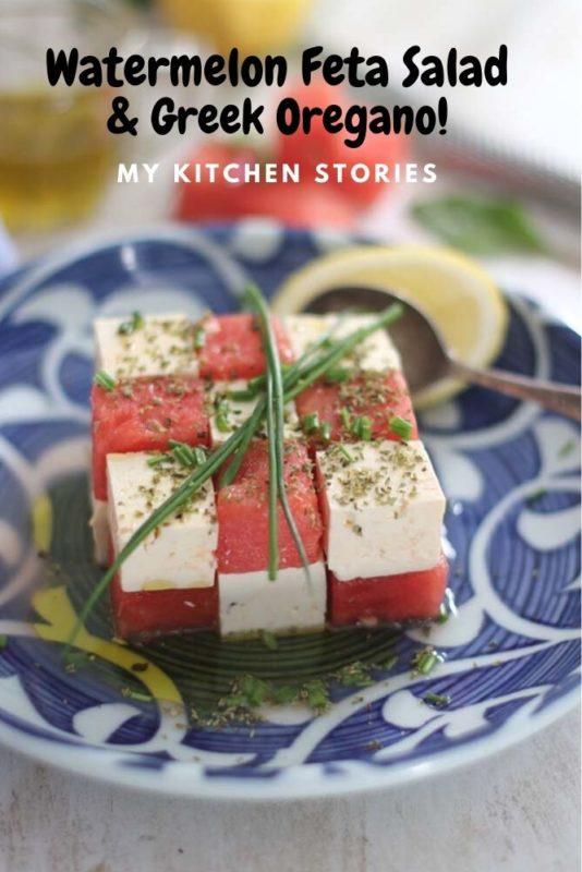 Feta and watermelon cut into cubes with greek oregano