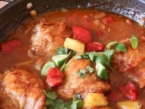 baked chicken with sweet and sour sauce in a pot
