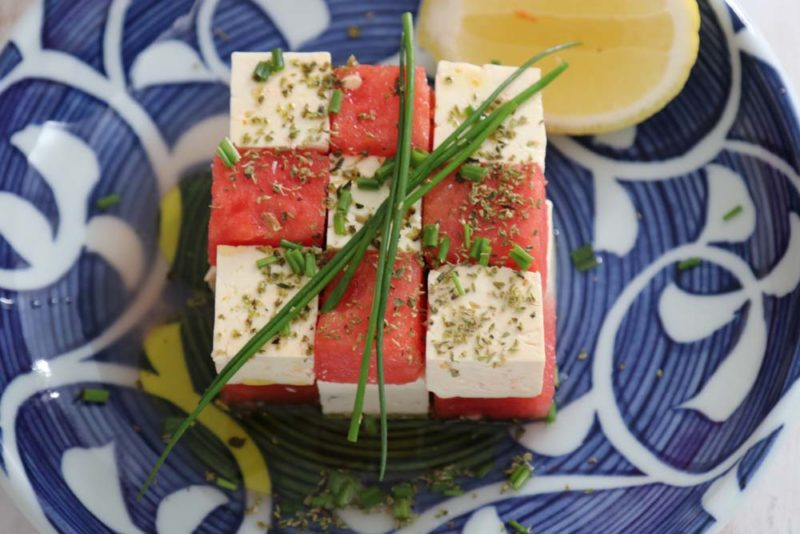 Squares of watermelon and feat on a plate