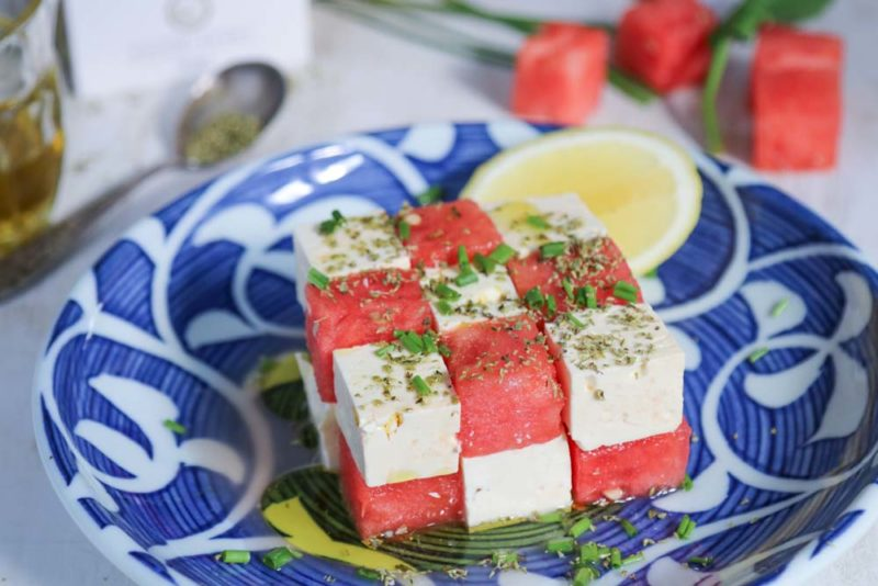 Watermelon and feta cut up and staked on a plate
