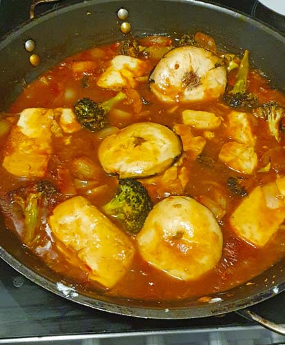 Baked vegetables in a pot of sweet and sour sauce
